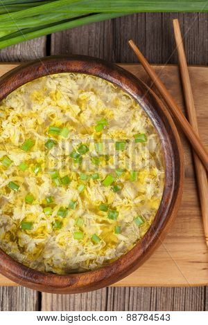 Traditilinal asian soup with eggs and mushrooms ready to eat