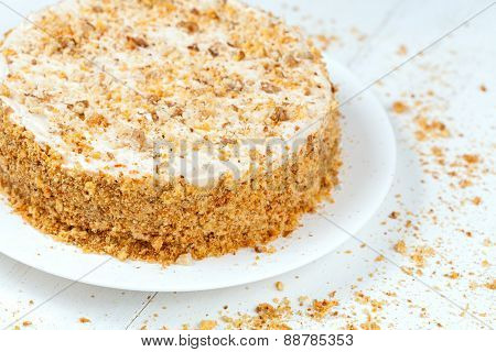Gourmet easter carrot cake with cream and nut crumbs