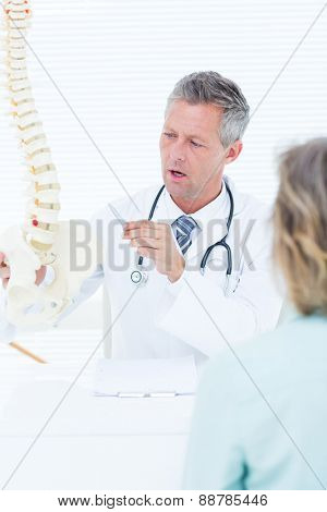 Doctor having conversation with his patient in medical office