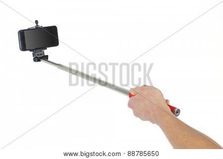 Woman taking a selfie shot in studio
