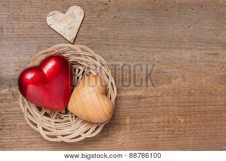 Three hearts on wood