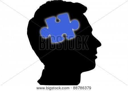 Jigsaw piece against silhouette of head
