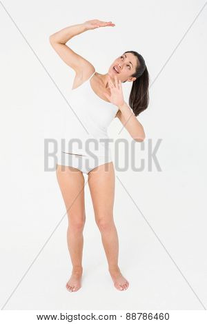 Terrified brunette looking up on white background