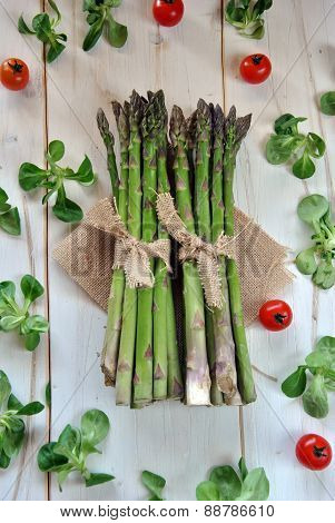 Organic Asparagus On Wooden Table