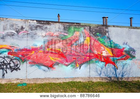 Colorful Graffiti With Chaotic Red Pattern Over Old Gray Concrete Garage Walls