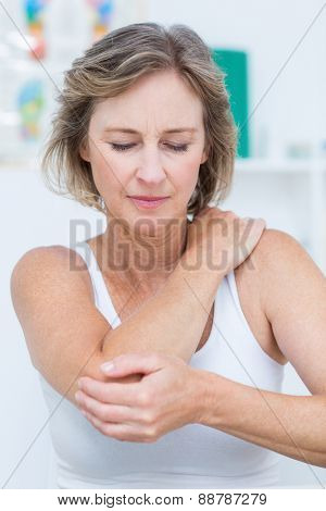 Woman having elbow pain in medical office