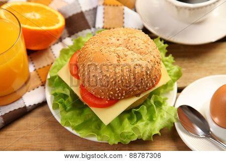 tasty burger on wooden table
