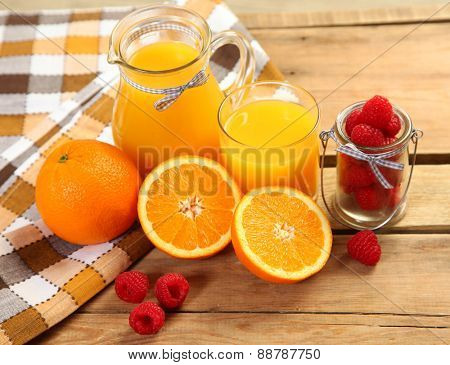 fresh orange juice and ripe fruits