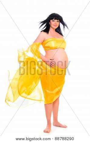 happy pregnant woman with yellow material isolated on white background