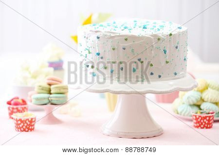 Birthday decorated cake on white wall background