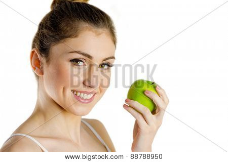 Slim woman holding green apple on white background