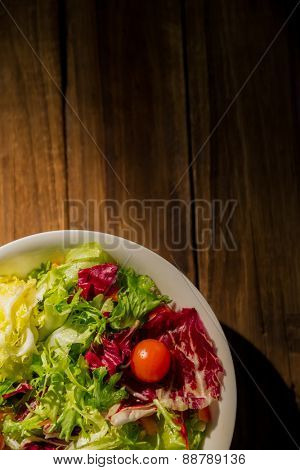 Healthy salad on wooden table