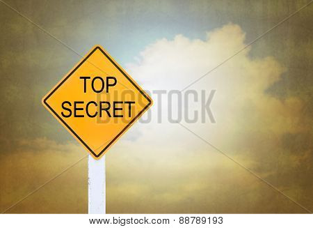 Road Sign Indicating Top Secret On Blurred Vintage Background