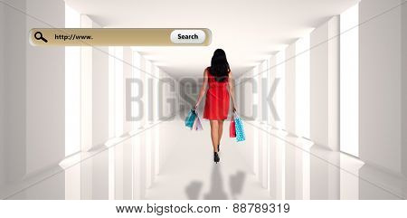 Woman standing with shopping bags against digitally generated room