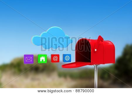 Red email postbox against mountain trail