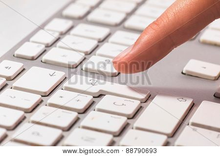 Female Office Worker Typing On The Keyboard