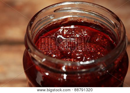 Jar of strawberry jam close up