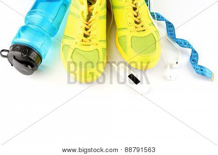 Sport shoes and bottle of water isolated on white