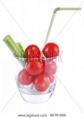 Cherry tomatoes and sticks of celery in glass with tube isolated on white
