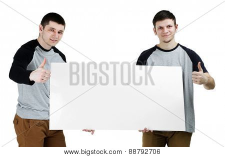 Two handsome young men holding blank poster isolated on white