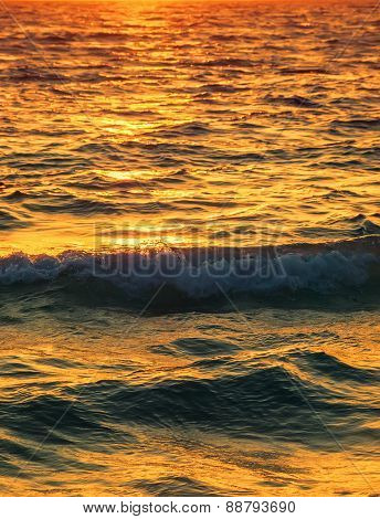 Sea water surface with setting sun light reflection vertical background.
