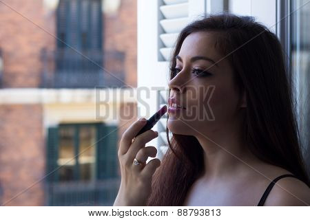Girl Applying Lipstick