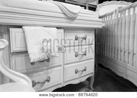 White chest of drawers with a towel
