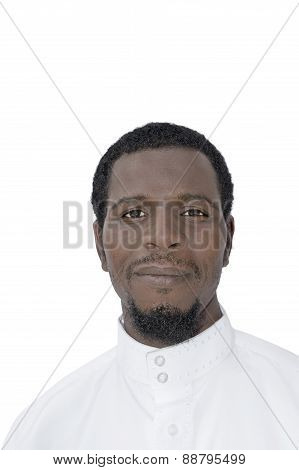 Portrait of an Afro man wearing a white djellaba, isolated