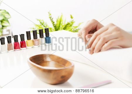 Woman in nail salon with hails in bath