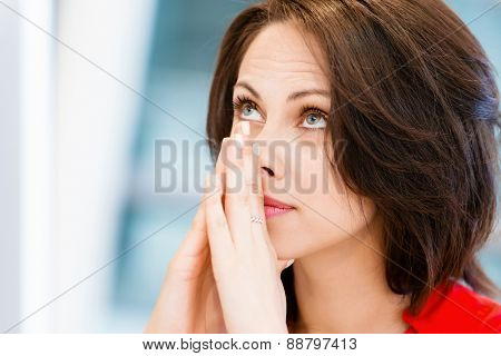 Modern business woman thinking about something