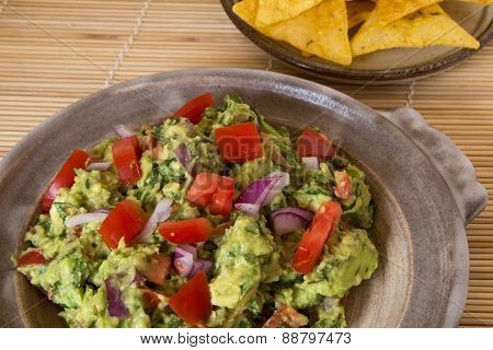 Homemade guacamole in a pottery dish
