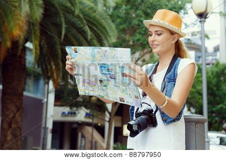 Happy young woman with a map