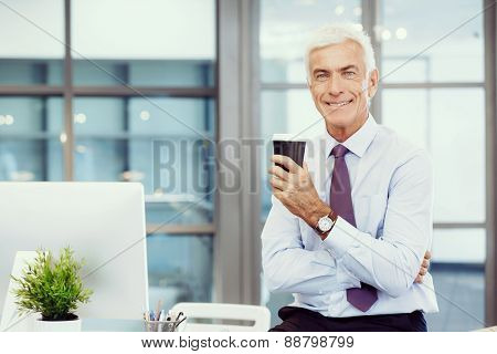 Businessman in office with a cup