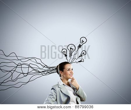 Young thoughtful businesswoman and thoughts coming out of her head