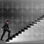 pic of climbing wall  - Concept or conceptual 3D man or  businessman climbing on a stair or steps near a wall background - JPG