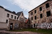stock photo of framing a building  - Many abandoned and ruined buildings are located in the Old Town of Vilnius City - JPG