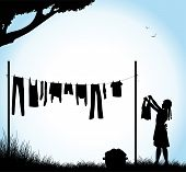 pic of laundry  - silhouette of girl who stretches the laundry - JPG