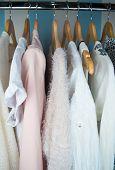 stock photo of wardrobe  - row of white dress in wardrobe at home  - JPG