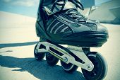 pic of skate  - closeup of the feet of a young man roller skating with inline skates - JPG