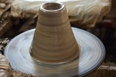 foto of molding clay  - potter making a clay pot in thailand - JPG