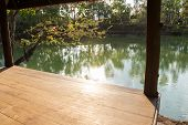 pic of gazebo  - view from the wooden gazebo beside the lake which can see the sunlight ripple and reflection - JPG