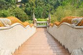 stock photo of bannister  - naga statue decorating on bannister of stairway in asian temple - JPG