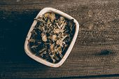 picture of oregano  - dried oregano on old wood background - JPG