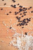 picture of crystal salt  - top view of  salt crystals and black peppercorns - JPG