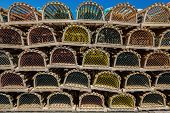 picture of lobster trap  - Stack of lobster traps on a wharf in rural Prince Edward Island - JPG