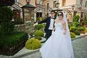 stock photo of rap-girl  - Young Beautiful Wedding Couple With Dark Glasses - JPG