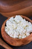 picture of curd  - curd in brown wooden bowl closeup - JPG