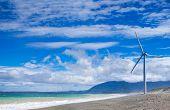 stock photo of generator  - Wind turbine power generators silhouettes at ocean coastline - JPG