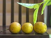 image of passion fruit  - Passion fruits and Green Leaf on Wooden Background - JPG