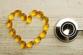 picture of cod  - Heart of cod liver oil and stethoscope - JPG